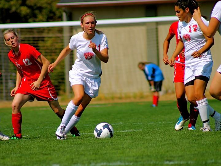 Leah Wessler fights for the ball during a Lady Grizz soccer game