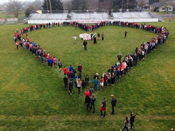 Taken by Michelle Zundel, students gather to make a heart